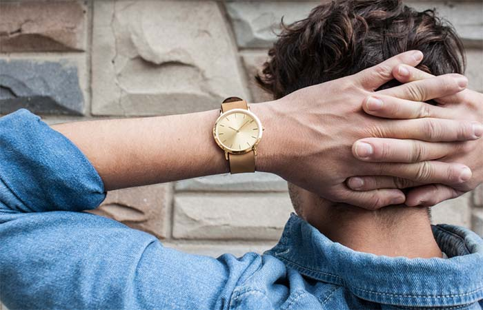 A guy wearing golden Classic Collection Analog Watch