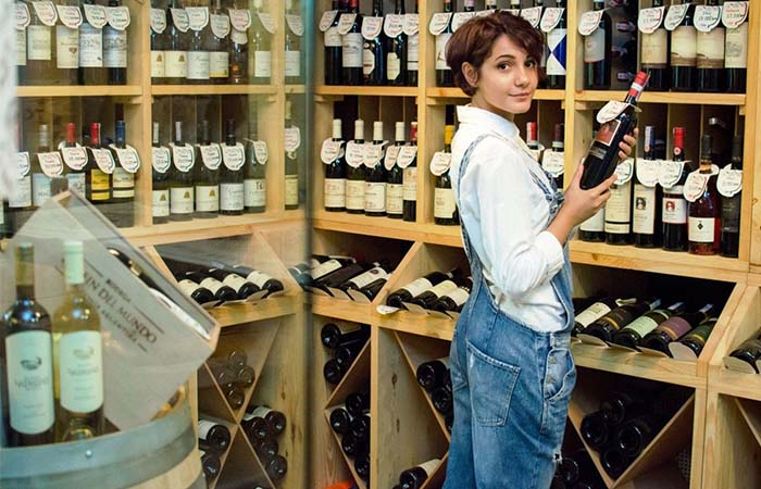 A girl holding wine in Wine Republic Yerevan