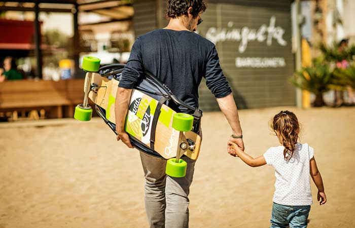 A man and his daughter walking with Longboardstroller