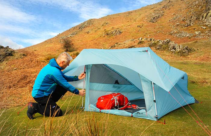 A guy pitching MSR Flylite 2-Person Tent