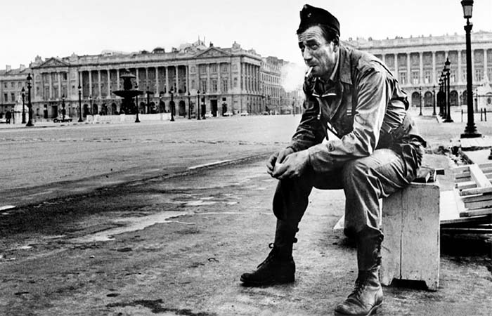 Soldier sitting on a bench in Is Paris Burning film