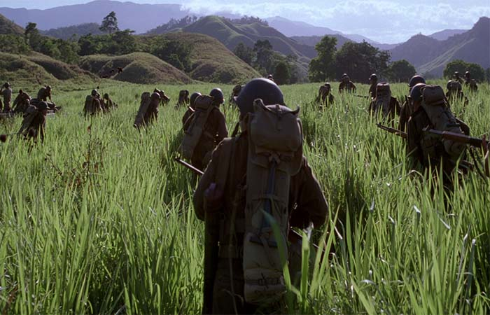 Soldiers walking on the field of grass in The Thin Red Line