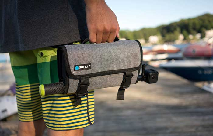 Weather Resistant Roll-Up Case for GoPro Cameras by GoPole in a man's hand