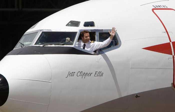 John Travolta in an airplane