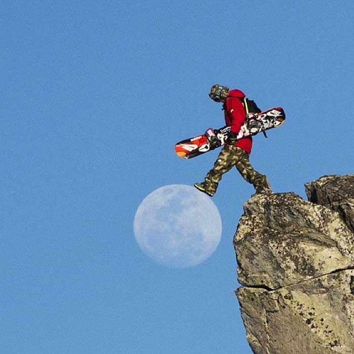 Snowboarder stepping on the Moon.