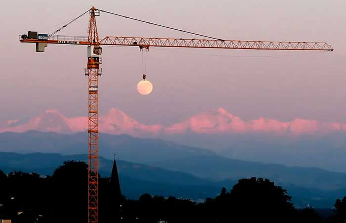 A crane holding the moon