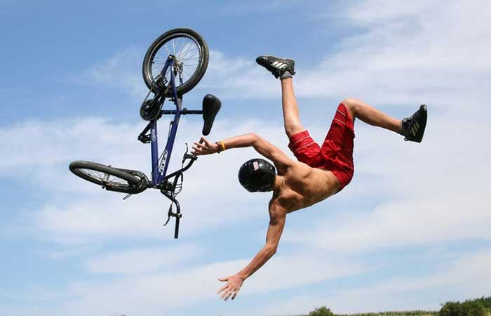 A cyclist falling from his bike in air