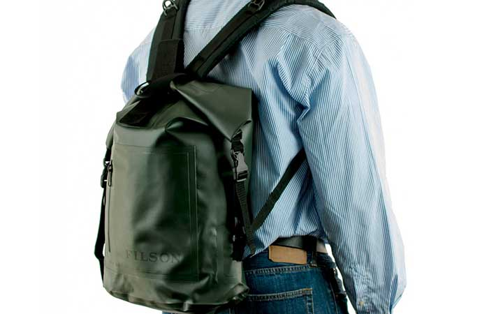 A man wearing Dry Day Backpack