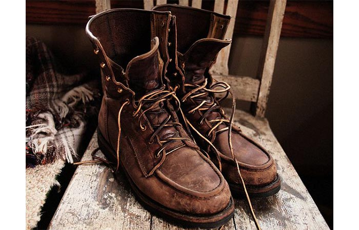 The pair of worn out Filson Men's Water-repellant Uplander Boots