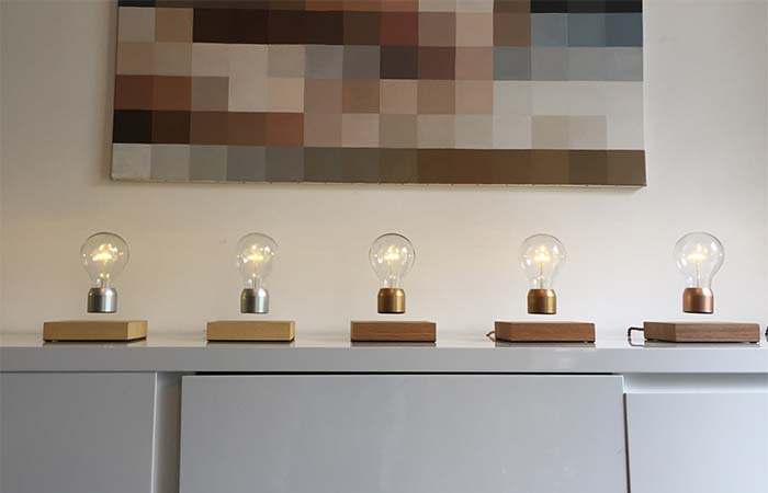 Five Flyte Light Bulbs Placed On The White Shelf