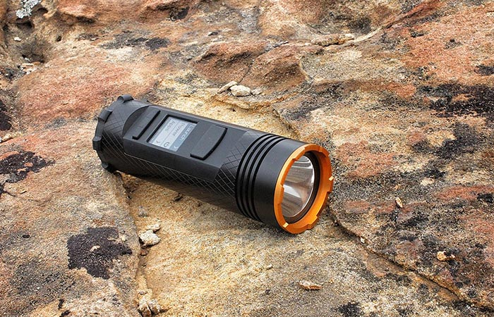 Fogo Flashlight on the ground
