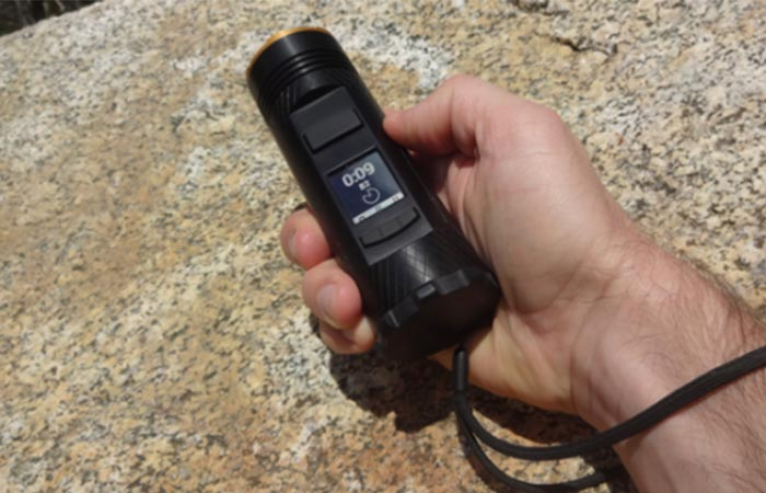 A hand holding Fogo Flashlight