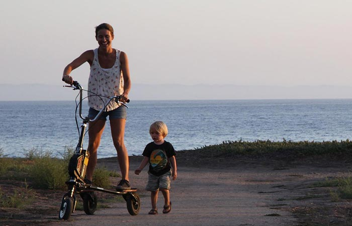 A woman with Freedom Electric Stand Up Trikke