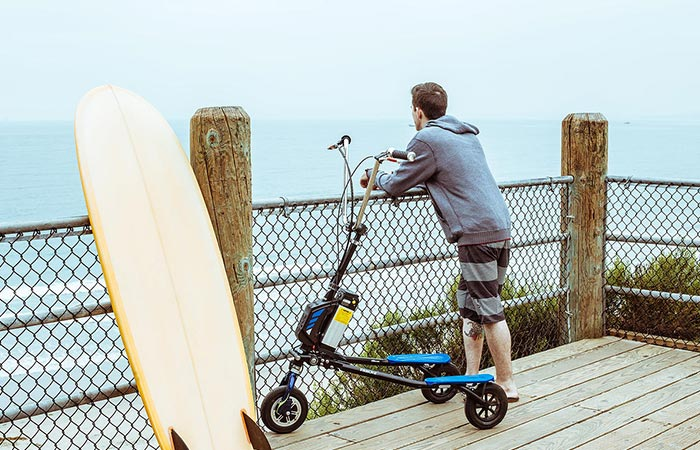 A guy with Freedom Electric Stand Up Trikke