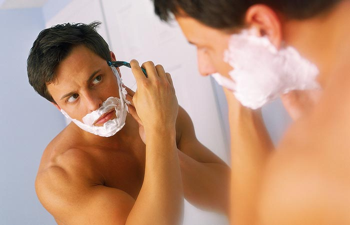 A man shaving beard