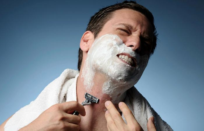 A man shaving in pain