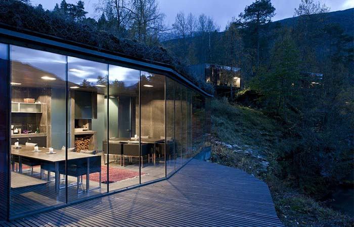 Glass windows and the look on Norway's Juvet Landscape Hotel dining room