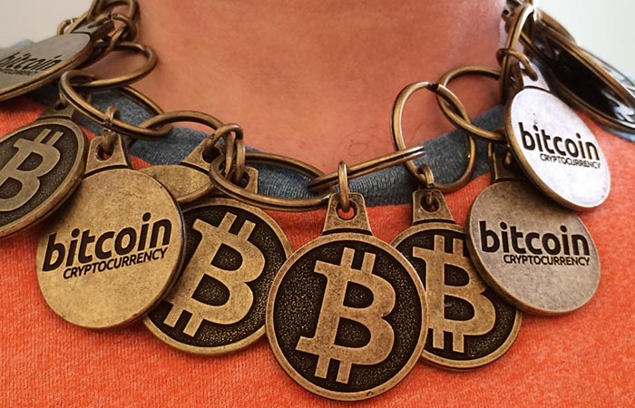 Necklace with Bitcoin logos.