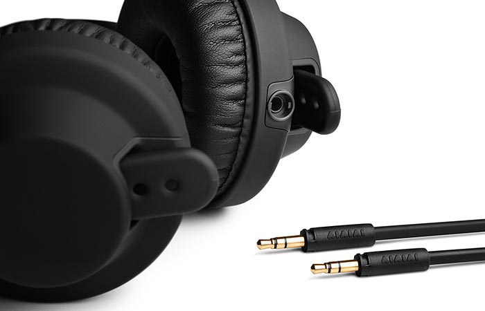 The lower part of the headphones with some cables.