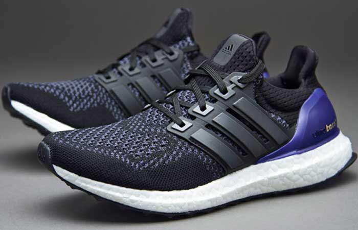 Adidas Men's Ultra Boost Running Shoe , black/grey/blue, on a grey background, side view.