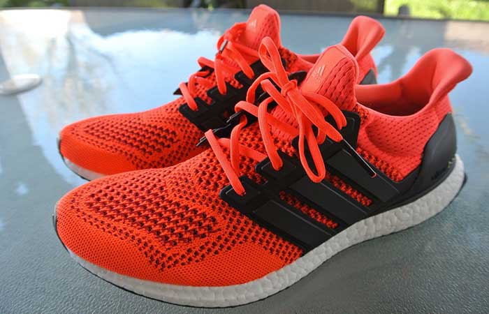 Adidas Men's Ultra Boost Running Shoe , red/black, outdoor, on a grey surface, side ivew.
