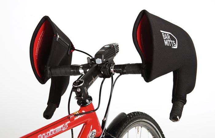 The Bar Mitts Hand Covers, black/red, attached to a red bicycle.White background.