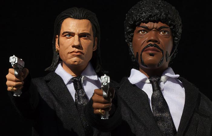 Vincent Vega and Jules Winnfield action figures pointing their guns, front view, upper body.