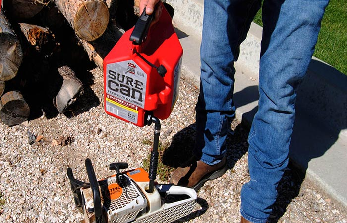 Pouring gas from Surecan Gas Can