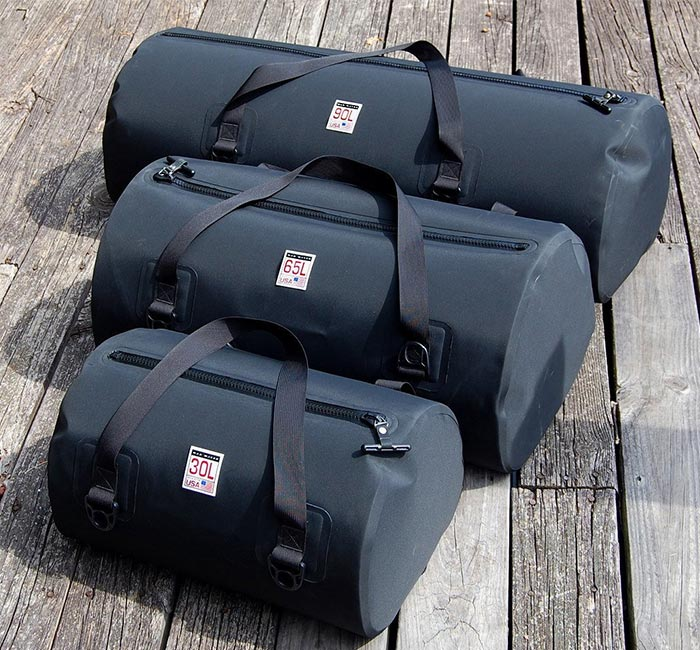 Three duffel bags captured together.