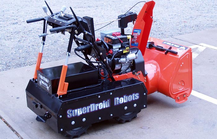 Snow Blower captured on the street from the side.