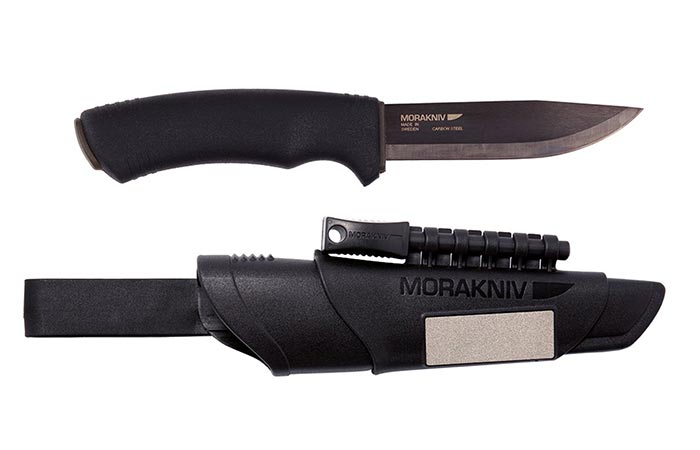 A knife and a case photographed from the side.