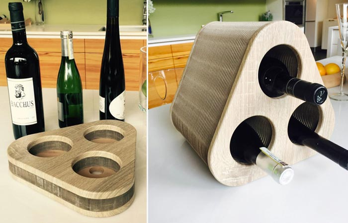 Deck Wine Holder on a kitchen worktop, closed and empty, and extended and filled with three wine bottles.