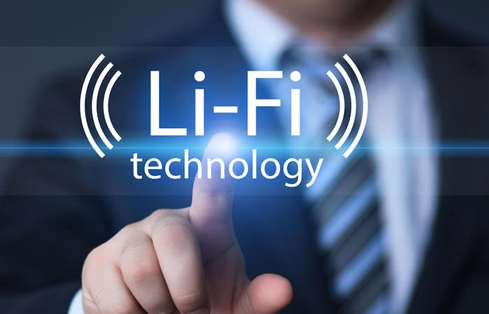 A man pointing a finger with LED light sparkling and a caption saying ''Li-Fi technology''.
