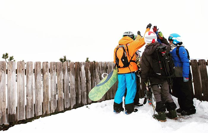 Four people wearing LinkPro Sports 'Explore1' Skiing Helmets