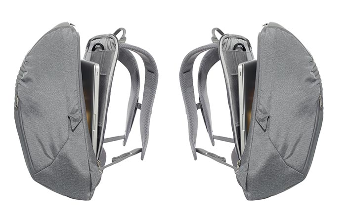 Two North Face Access Packs, grey, slightly open with a laptop inside, oriented in opposite sides.