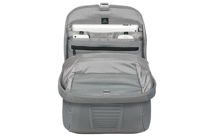 North Face Access Pack, grey, half open, with a white laptop and two phones in inside pockets. On a white background.