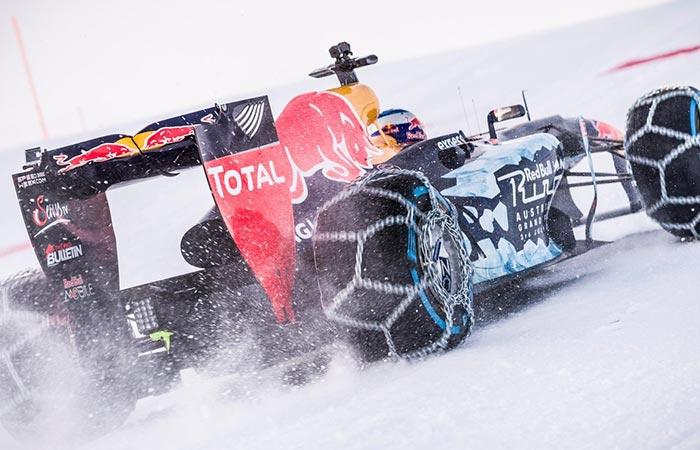 Formula 1 car drifting on the snow.