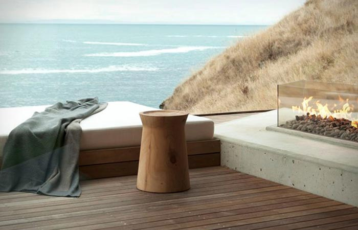 Seascape Retreat on a South Pacific Cove, terrace with a chair and a fireplace.
