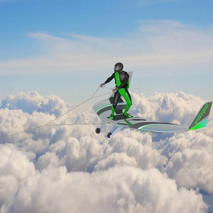 Guy wingboarding above the clouds.