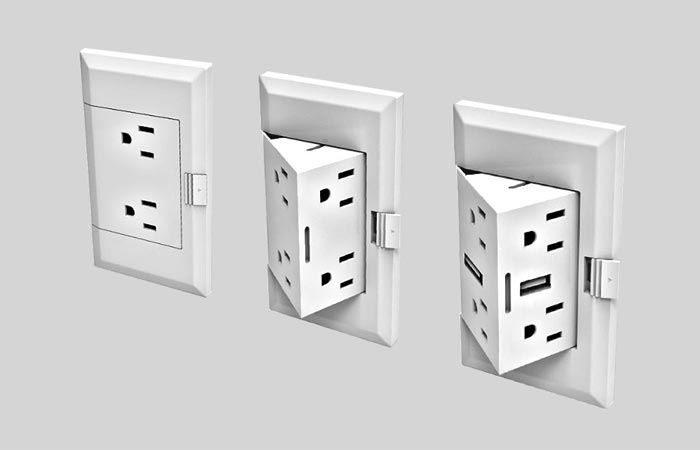 theOUTlet innovation in three electrical boxes on a grey wall, one hidden, and two open devices.