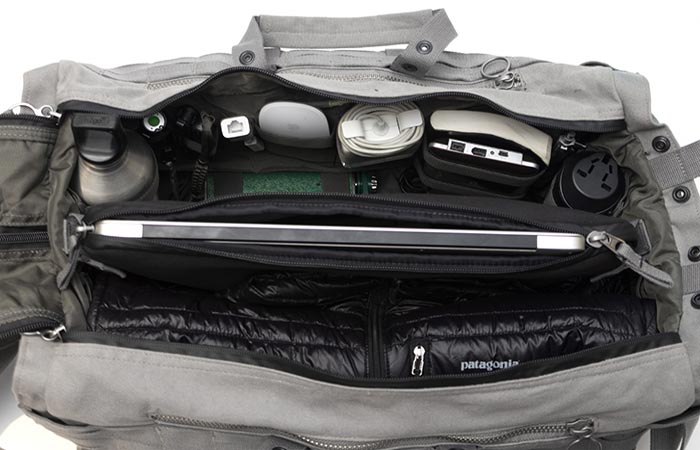 Able Archer Duffel, cement, with the laptop in the center sleeve and numerous accessories in other compartments. Upper view.