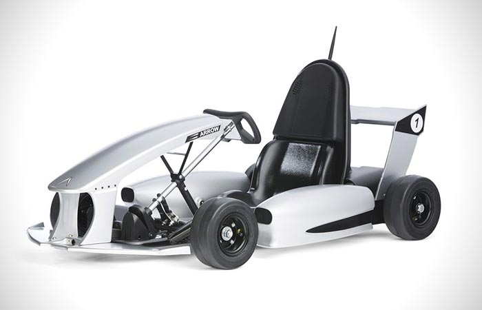 A white Smart-Kart captured from the side.