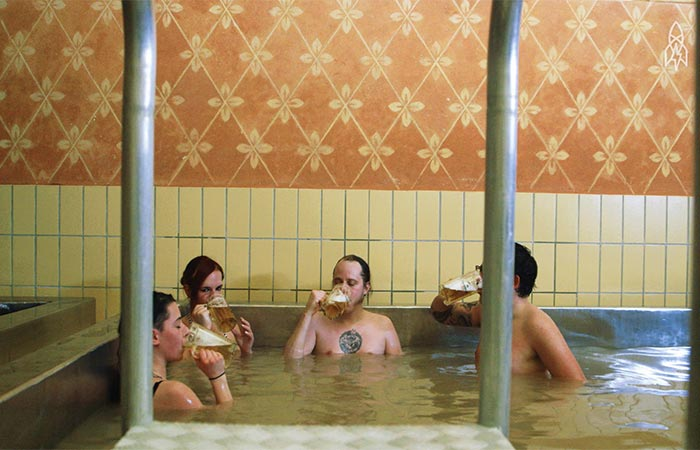 People Sitting In Beer Hot Tub and Drinking Beer