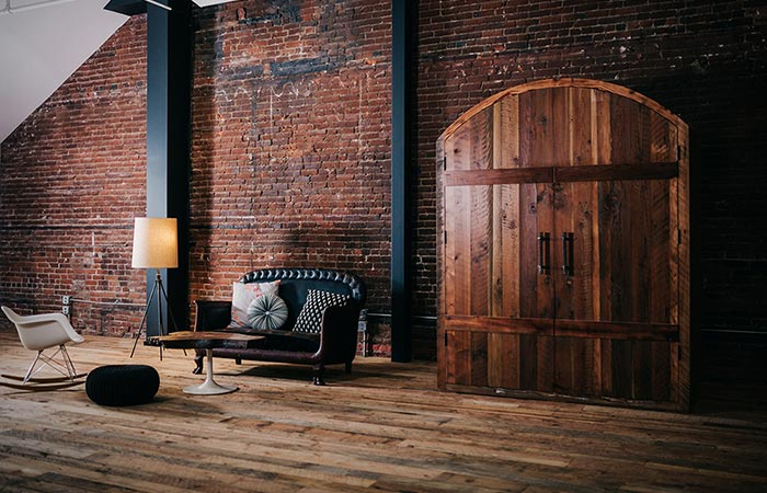 Sommi WIne Cellar in a room with wooden floor and brick wall, closed.