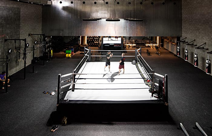 The boxing ring with boxers in it.