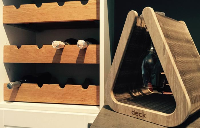 The Deck - Flexible Goblet Holder filled with glasses, next to a wine rack.