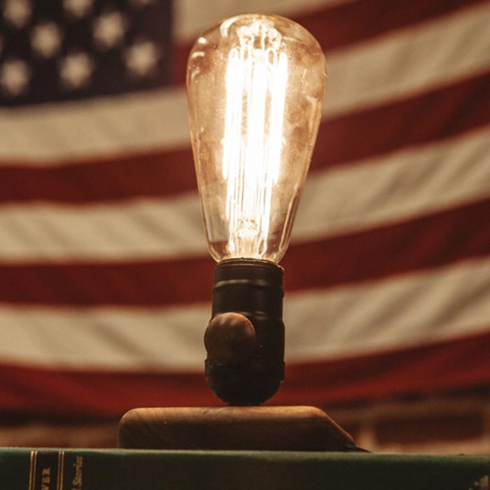 The lamp captured with the United States flag behind it.