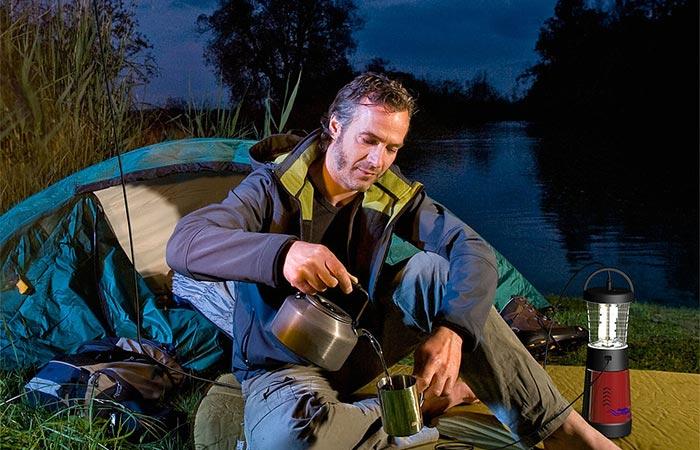 A Guy Camping And Using Hydra Light Lantern