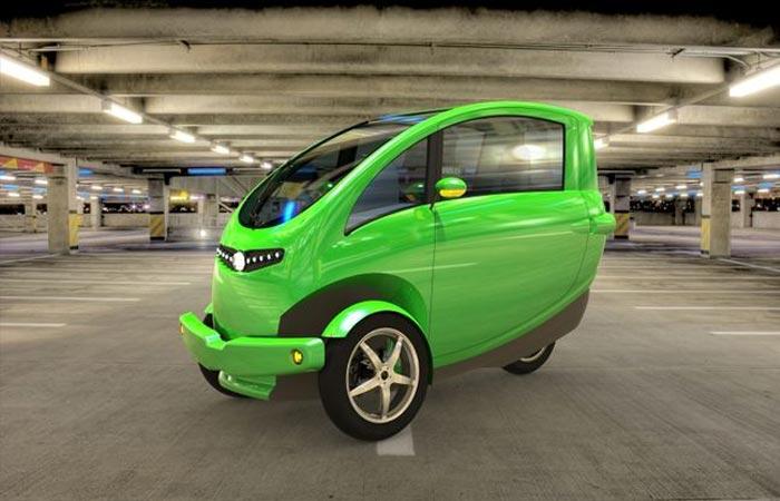 Veemo Velomobile, green, on an indoor parking, tilted.