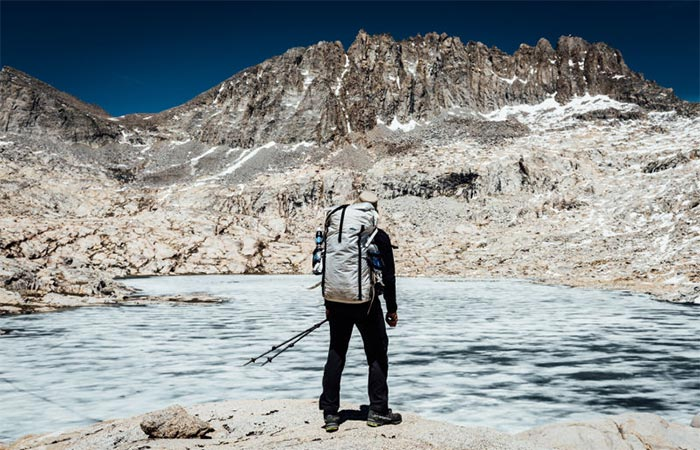 A Guy Wearing 4400 White Porter Pack Next To A Lake